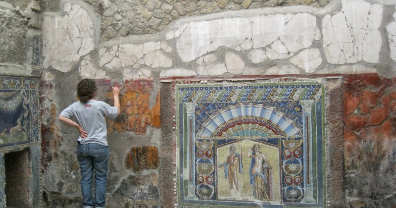 Ercolano, Italy - May 17, 2013: Archaeologist  restoring ancient mosaic of Ercolano, Naples.Photo taken in Ercolano, bay of Naples.