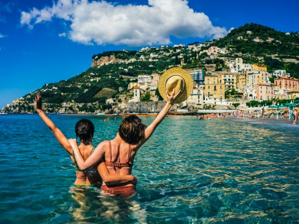 105870646 – two happy girlfriends making fun on the coast of tropical sea